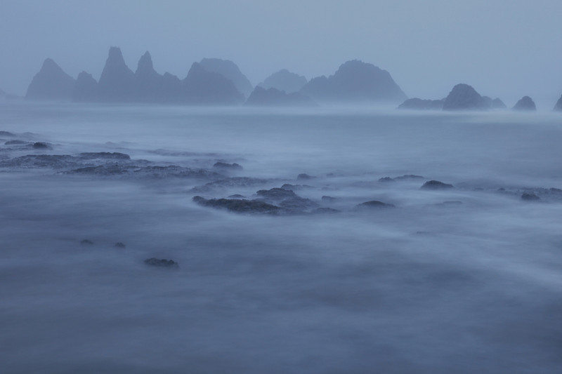 "SATURDAY, DECEMBER 19, 2009<br /> <br /> OREGON 3291<br /> <br /> ""Foggy evening at Seal Rocks""<br /> <br /> I found another cool place today, known as Seal Rocks, or Seal Rock State Wayside. Unfortunately, even though I spent almost two full days in this area it rained almost the entire time and so I never was able to catch a spectacular sunrise or sunset at this location. However, I tried to make the best of it. <br /> <br /> The image shown here was captured about a half hour after sunset on a very foggy evening. I had to use a 25 second exposure in order to get enough light for the image to expose properly.<br /> <br /> Camera: Canon EOS 5D Mark II<br /> Lens: Canon EF 24-105mm<br /> Focal length: 58mm<br /> Shutter speed: 30 seconds<br /> Aperture: f/8<br /> ISO: 200"