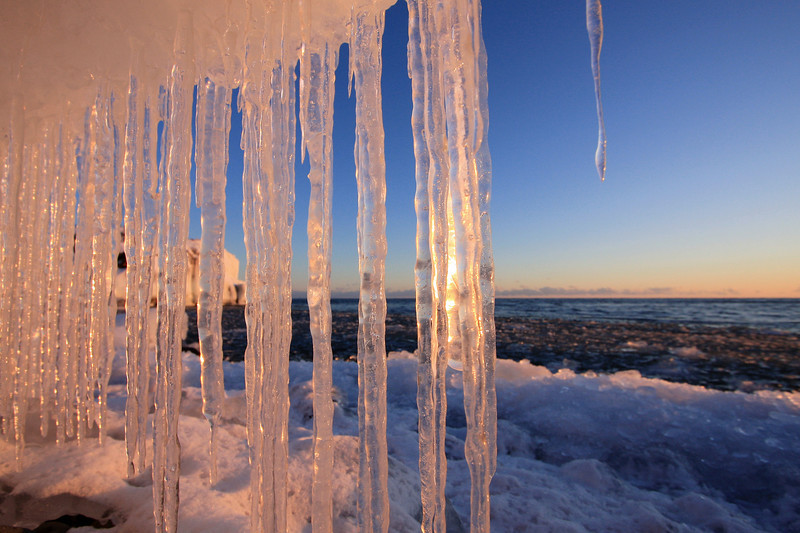 "WEDNESDAY, JANUARY 28, 2009<br /> <br /> SUPERIOR WINTER 4878<br /> <br /> ""Afternoon Icicles""<br /> <br /> We are moving into one of my favorite times of the year... when the ice starts to form and build up on the shores of Lake Superior! Its a bitter cold time of the year, but I look forward to it anyway. Ice is easily one of my favorite things to photograph. In the last week of January there were numerous interesting ice formations to photograph. I'm sure there will be much more on the way!<br /> <br /> Camera: Canon EOS 40D<br /> Lens: Canon EF-S 10-22mm<br /> Focal length: 10mm<br /> Shutter speed: 1/200<br /> Aperture: f/8<br /> ISO: 200"