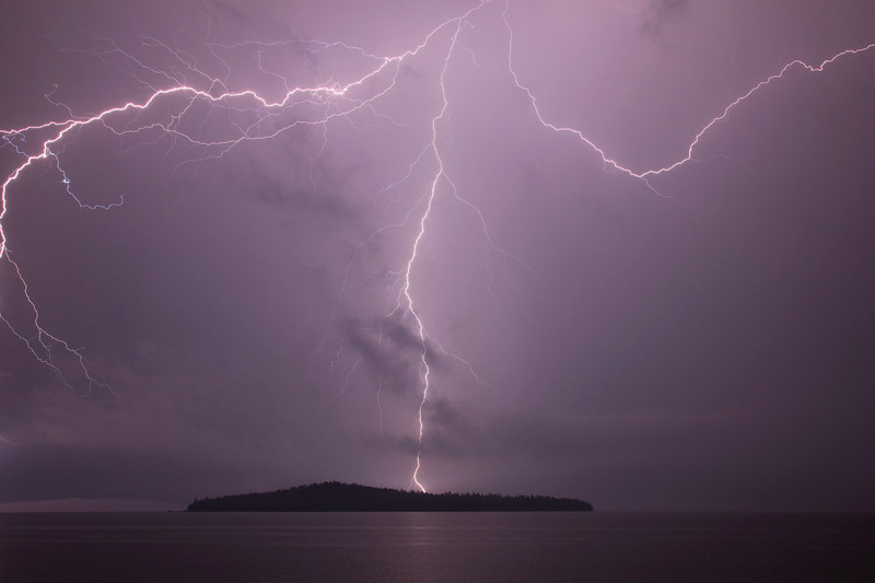 """THURSDAY, JUNE 18, 2009<br /> <br /> LIGHTNING 2562<br /> <br /> """"Trifecta""""<br /> <br /> This evening an incredible series of thunderstorms rolled across Grand Portage Bay between 9:00 p.m. and 1:00 a.m. It was some of the most intense lightning I've ever seen in this area. I photographed the lightning for almost 3 hours from my boat shed on the Lake Superior shoreline. The image above was a 9 second exposure, with an aperture of f/8 and the ISO set at 200. I got really lucky on the image below, as the lightning flashed almost immediately after I hit the button on the remote shutter release, and it was a very bright flash so I hit the button again right after the flash. It ended up being only a one second exposure!<br /> <br /> Camera: Canon EOS 5D Mark II<br /> Lens: Canon EF 24-105mm<br /> Focal length: 32mm<br /> Shutter speed: 9 seconds<br /> Aperture: f/8<br /> ISO: 200"""