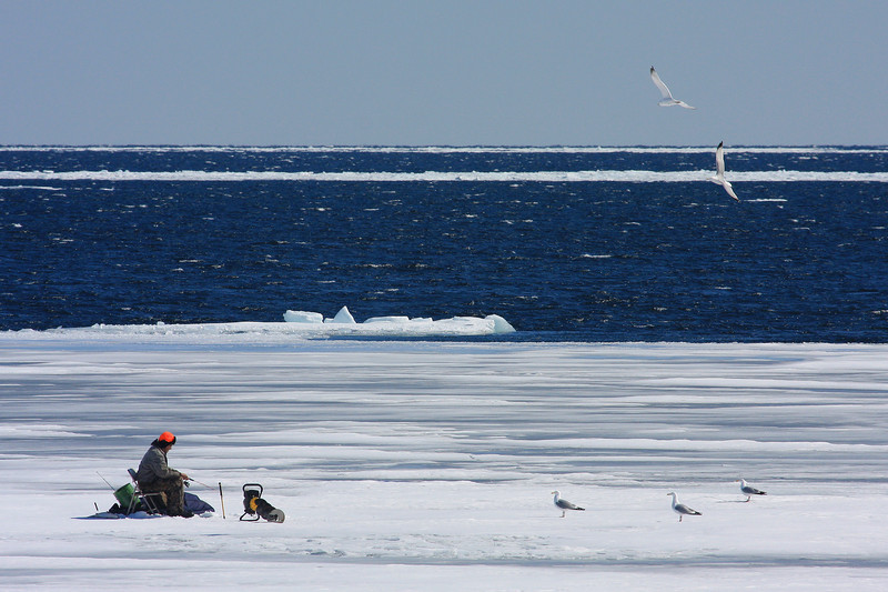 "SATURDAY, MARCH 21, 2009<br /> <br /> SUPERIOR WINTER 6638<br /> <br /> ""Ice fishing on Wauswaugoning Bay""<br /> <br /> Camera: Canon EOS 40D<br /> Lens: Canon EF 100-400mm<br /> Focal length: 400mm<br /> Shutter speed: 1/1000<br /> Aperture: f/11<br /> ISO: 200"