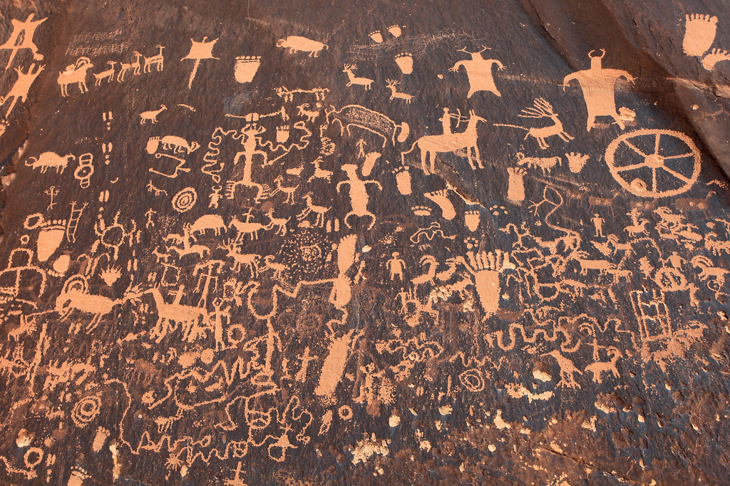 "THURSDAY, APRIL 1, 2010<br /> <br /> UTAH 7806<br /> <br /> ""Newspaper Rock""<br /> <br /> Some other highlights from today: Stopped by Newspaper Rock in Canyonlands National Park, an amazing rock which has probably the highest concentration of petroglyphs of any single rock in the Southwest. I also drove through some intense rain today, followed by some amazing skies as the storm broke up.<br /> <br /> Camera: Canon EOS 5D Mark II<br /> Lens: Canon EF 17-40mm<br /> Focal length: 38mm<br /> Shutter speed: 1/320<br /> Aperture: f/13<br /> ISO: 200"