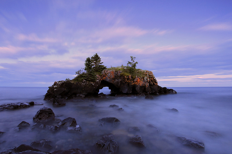 "WEDNESDAY, JULY 21, 2010<br /> <br /> SUPERIOR SUMMER 8060<br /> <br /> ""Summer's Eve at Hollow Rock""<br /> <br /> This is the first image I've made at Hollow Rock in quite some time. Hollow Rock is one of my favorite places to photograph in winter, but for some reason I don't go there much in the summer. I don't know why, since it is a great place to shoot no matter what the season. At any rate, this image was made at 9:37 p.m. It is a 30 second exposure shot with the aid of a 3-stop reverse-graduated neutral-density filter. The hardest part about making this image was tolerating the mosquitoes. They were AWFUL!<br /> <br /> Camera: Canon EOS 5D Mark II<br /> Lens: Canon EF 17-40mm<br /> Focal length: 17mm<br /> Shutter speed: 30 seconds<br /> Aperture: f/7.1<br /> ISO: 200"