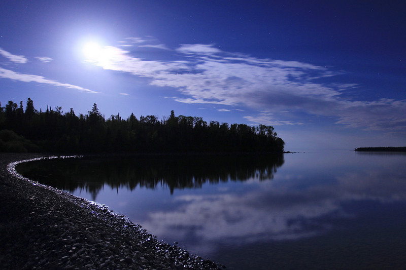 "SATURDAY, MAY 29, 2010<br /> <br /> MOONLIGHT 9240<br /> <br /> ""May Moon over Pete's Island""<br /> <br /> After I had photographed the aurora looking to the north above the village of Grand Portage, I turned around and saw this incredible moonscape laid out before me looking to the south. This image was an unexpected treat of the evening as I had only been expecting to capture the northern lights, not a nice moonscape as well! This image was made with a Canon EF 17-40 lens, aperture f4, ISO 800. Exposure length was 20 seconds. White balance was set to fluorescent to bring out the blue in the sky. And yes, those are stars in the sky :-)<br /> <br /> Camera: Canon EOS 5D Mark II<br /> Lens: Canon EF 17-40mm<br /> Focal length: 24mm<br /> Shutter speed: 20 seconds<br /> Aperture: f/4<br /> ISO: 800"