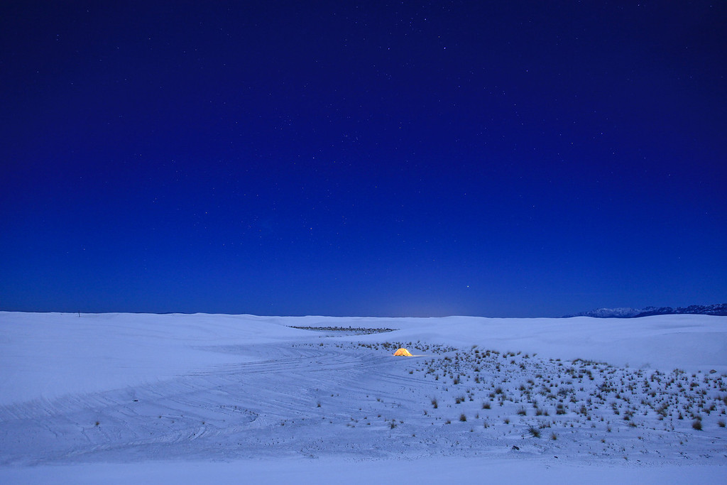 "FRIDAY, JANUARY 1, 2010<br /> <br /> NEW MEXICO 4941<br /> <br /> ""Moonlit campsite in the dunes - New Year's Eve 2009""<br /> <br /> White Sands is an awesome landscape during the day, but switch to night and throw in the light from a full moon and its downright magical! We had a blast hiking around the dunes and taking pictures. It was a lovely night, the air was crisp but not too cold and there wasn't a lick of wind. Its pretty amazing when its so still and you can't hear anything except for your own breathing. Thule (Roger's dog) even seemed to really enjoy the night as he was friskier than usual, running laps around us and jumping up and down. <br /> <br /> Camera: Canon EOS 5D Mark II<br /> Lens: Canon EF 24-105mm<br /> Focal length: 24mm<br /> Shutter speed: 10 seconds<br /> Aperture: f/4<br /> ISO: 400"