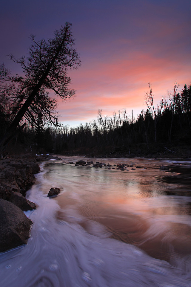 "SATURDAY, APRIL 23, 2011<br /> <br /> RIVERS 9573<br /> <br /> ""April Sunset, Temperance River""<br /> <br /> Temperance River State Park near Tofte, MN. I made this image a couple of nights ago after a ""spur of the moment"" decision to drive down to Temperance and photograph the sunset. It was cloudy in Grand Portage, but I figured what the heck I'd give it a shot. It's a good thing I did, as there was a beautiful sunset that evening!<br /> <br /> Camera: Canon EOS 5D Mark II<br /> Lens: Canon EF 17-40mm<br /> Focal length: 17mm<br /> Shutter speed: 1.3 seconds<br /> Aperture: f/16<br /> ISO: 50"