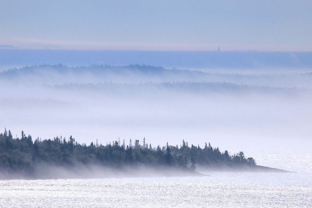 "WEDNESDAY, AUGUST 31, 2011<br /> <br /> SUPERIOR SUMMER 1795<br /> <br /> ""Late summer fog, Susie Islands""<br /> <br /> Susie Islands and fog in late August. Rock of Ages Lighthouse (part of Isle Royale National Park) can be seen in the distance on the horizon.<br /> <br /> Camera: Canon EOS 5D Mark II<br /> Lens: Canon EF 100-400mm<br /> Focal length: 400mm<br /> Shutter speed: 1/1600<br /> Aperture: f/16<br /> ISO: 400"