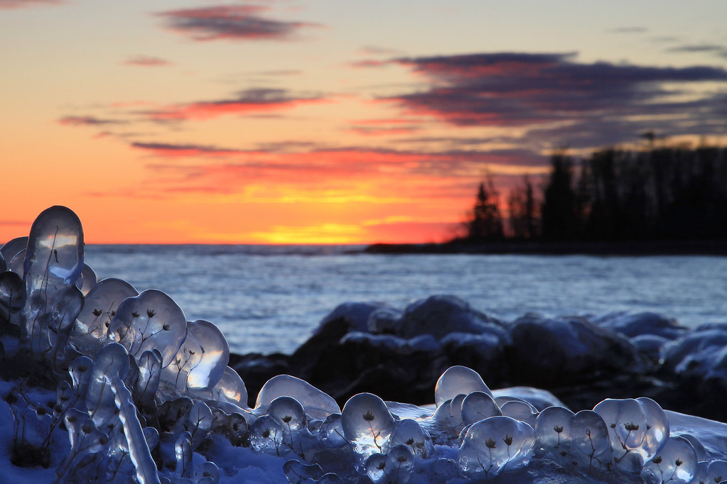 "WEDNESDAY, DECEMBER 7, 2011<br /> <br /> SUPERIOR WINTER 6817<br /> <br /> ""Ice Crystal Sunset""<br /> <br /> This evening I tried out a ""new"" (to me) location along the Lake Superior shoreline North of Grand Marais, MN. It turned out to be a wonderful spot and I had great fun spending the evening shooting here. I still can't believe I've never been down to this spot before! It is just a short walk from Highway 61, and is actually part of the Superior Hiking Trail. Many thanks to my friend Bryan Hansel  <a href=""http://www.flickr.com/photos/bryanhansel/"">http://www.flickr.com/photos/bryanhansel/</a>) for letting me know about this amazing little slice of Lake Superior's shore. <br /> <br /> Camera: Canon EOS 5D Mark II<br /> Lens: Canon EF 24-105mm<br /> Focal length: 105mm<br /> Shutter speed: 1/5<br /> Aperture: f/22<br /> ISO: 200"