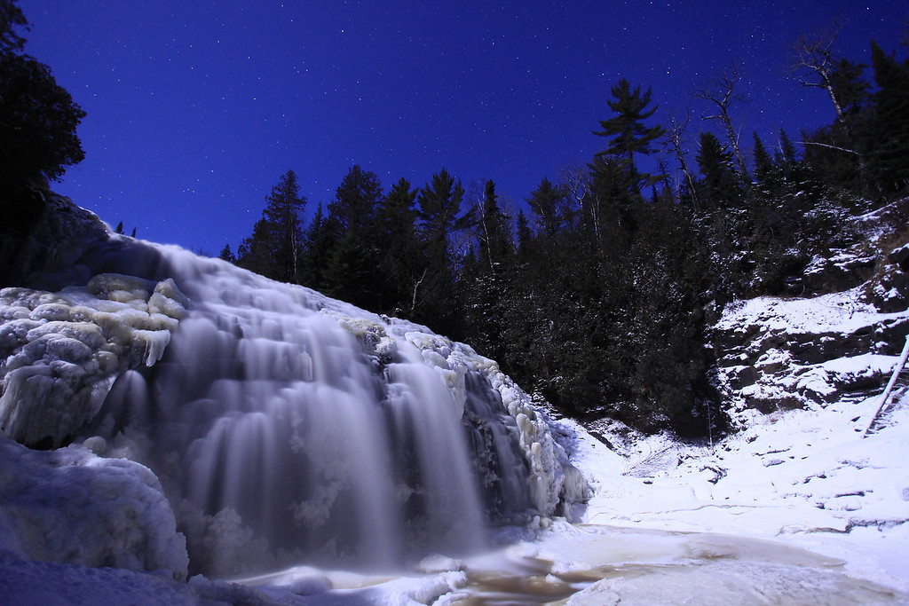 "WEDNESDAY, DECEMBER 7, 2011<br /> <br /> MOONLIGHT 6887<br /> <br /> ""December moonlight on Partridge Falls""<br /> <br /> After shooting for about an hour and a half along the Lake Superior shore, I headed home for a bite to eat. As soon as my stomach was full I headed back out to do some more shooting. It was a beautiful moonlit night and I wasn't about to let that go to waste! So, I headed up along the Pigeon River and made some photos of Partridge Falls bathed in moonlight. What a great day for some early winter photography!<br /> <br /> Camera: Canon EOS 5D Mark II<br /> Lens: Canon EF 17-40mm<br /> Focal length: 17mm<br /> Shutter speed: 20 seconds<br /> Aperture: f/4<br /> ISO: 1600"