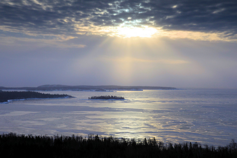 "WEDNESDAY, FEBRUARY 2, 2011<br /> <br /> SUPERIOR WINTER 4907<br /> <br /> ""Winter sun rays over the Susie Islands""<br /> <br /> I made this image on my way to work a few days ago. This view is from a highway overlook that looks down on Wauswaugoning Bay and the Susie Islands. I'm very lucky to be able to drive past this view on my way to and from work each day! It has provided for a spectacular photo opportunity more times than I can remember!<br /> <br /> Camera: Canon EOS 5D Mark II<br /> Lens: Canon EF 24-105mm<br /> Focal length: 70mm<br /> Shutter speed: 1/800<br /> Aperture: f/8<br /> ISO: 400"