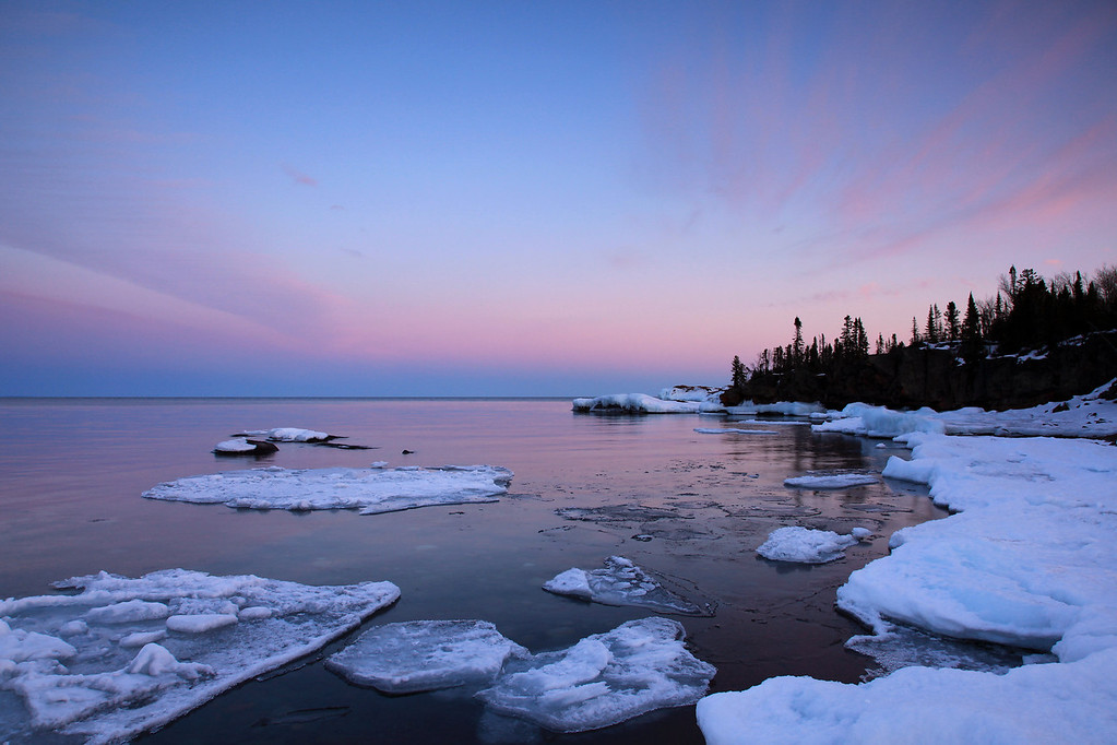 "WEDNESDAY, MARCH 30, 2011<br /> <br /> SUPERIOR WINTER 8916<br /> <br /> ""Late March Sunset at Red Rock Point""<br /> <br /> Last year when I went to the Southwest (pretty much at the same time as this year) all the ice was gone before I left on my trip. This year, I return home and still find plenty of ice along the shoreline. This was taken last night looking South across Lake Superior just after the sun went down. Amazing how each year can be so different! <br /> <br /> Camera: Canon EOS 5D Mark II<br /> Lens: Canon EF 24-105mm<br /> Focal length: 24mm<br /> Shutter speed: 0.3 sec<br /> Aperture: f/16<br /> ISO: 200"