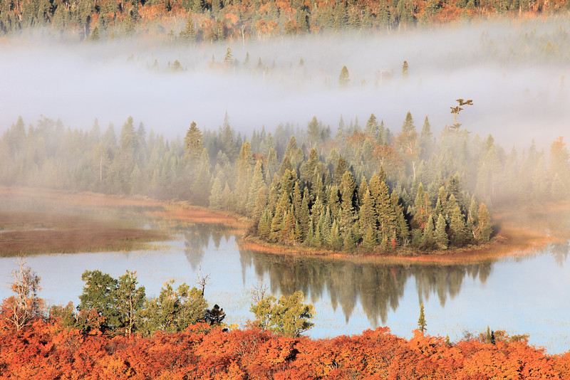 "TUESDAY, OCTOBER 6, 2011<br /> <br /> AUTUMN 3589<br /> <br /> ""Foggy Fall Morning""<br /> <br /> Taken Saturday morning of last weekend. An overnight low temperature of 28 degrees made for some beautiful fog over the inland lakes Saturday morning. Fog combined with fall colors... not many things make for better photo conditions!<br /> <br /> Camera: Canon EOS 5D Mark II<br /> Lens: Canon EF 100-400mm<br /> Focal length: 400mm<br /> Shutter speed: 1/250<br /> Aperture: f/16<br /> ISO: 500"