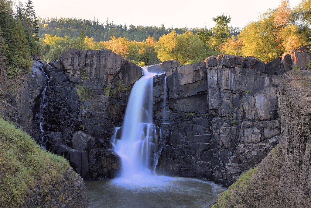 """THURSDAY, SEPTEMBER 22, 2011<br /> <br /> PIGEON RIVER 2702<br /> <br /> """"Early Autumn at High Falls, September 2011""""<br /> <br /> I made this image a couple of days ago on the Pigeon River at Grand Portage State Park. Normally I don't care for HDR (High Dynamic Range) photopraphy but in this instance I decided to try HDR, since my split grad filter just wasn't giving me very good results. The image you see here is a blending of 3 different photos at 3 different exposure settings, one exposed for the brightly-lit trees, one exposed for the dark foreground rocks and another one exposed for the middle areas of the scene.<br /> <br /> Camera: Canon EOS 5D Mark II<br /> Lens: Canon EF 24-105mm<br /> Focal length: 55mm<br /> Shutter speed: 1/4 sec<br /> Aperture: f/16<br /> ISO: 50"""