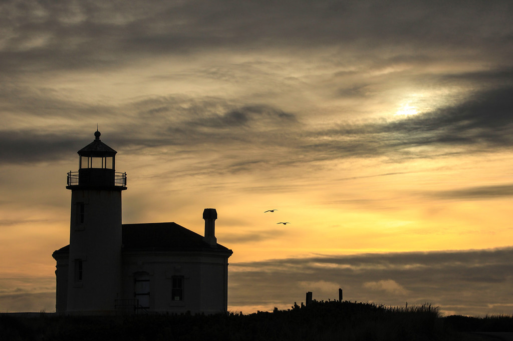 "SATURDAY, DECEMBER 1, 2012<br /> <br /> OREGON 8100<br /> <br /> ""Coquille River Light""<br /> <br /> I like photographing lighthouses, but most of the time I only enjoy it if there is a dramatic sky as a backdrop.  I think this one definitely fits that criteria.  This is the Coquille River Light, originally known as the Bandon Light in Bandon, Oregon.  The light was first lit on February 29, 1896 and contained a fourth-order Fresnel lens.  In September 1936 a large wildfire swept through the surrounding area and destroyed most of Bandon.  The town soon became bankrupt as a result of the decline in shipping.  The light was shut down in 1939 and replaced by an automated light on the south jetty.   <br /> <br /> Camera: Canon EOS 5D Mark II<br /> Lens: Canon EF 100-400mm<br /> Focal length: 135mm<br /> Shutter speed: 1/1000<br /> Aperture: f/13<br /> ISO: 400"