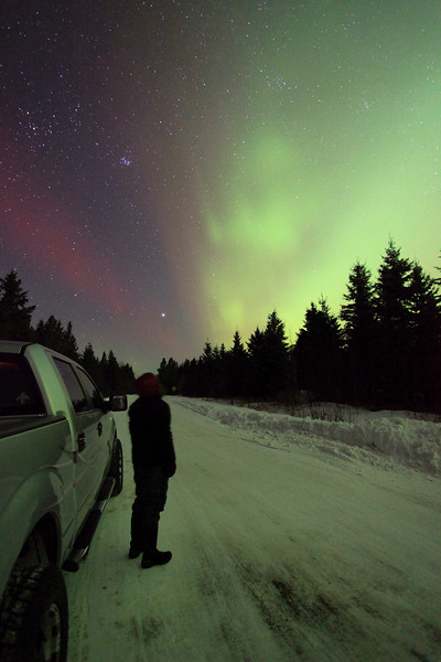 "FEBRUARY 18, 2012<br /> <br /> AURORA 4952<br /> <br /> ""Aurora Watching""<br /> <br /> After 3 very long months of not seeing any Auroras in Northern Minnesota (my last few opportunities were blocked by heavy cloud cover), the lights made a surprise appearance on the evening of February 18th. My girlfriend and I were just settling in to watch a movie when I decided to take a quick look online to check the auroral oval. To my surprise, the Kp index was measuring just over 4, which often means that we might see some good lights here. A quick look out the back door of my house revealed that yes indeed, the lights were out! We jumped in the truck and drove a few miles inland from Lake Superior to some better spots for viewing the lights. For the next hour and a half we were treated to a very nice display of green glow peppered with dancing curtains of green, purple and red. It was a spectacular night of Aurora viewing!<br /> <br /> Camera: Canon EOS 5D Mark II<br /> Lens: Canon EF 17-40mm<br /> Focal length: 17mm<br /> Shutter speed: 30 seconds<br /> Aperture: f/4<br /> ISO: 3200"
