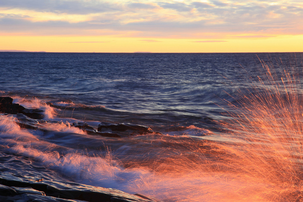 "FRIDAY, FEBRUARY 10, 2012<br /> <br /> SUPERIOR WINTER 4799-2<br /> <br /> ""Sunrise Splash""<br /> <br /> Here is a recent shot of Lake Superior waves captured at sunrise.  <br /> <br /> Camera: Canon EOS 5D Mark II<br /> Lens: Canon EF 24-105mm<br /> Focal length: 105mm<br /> Shutter speed: 1/5<br /> Aperture: f/16<br /> ISO: 100"