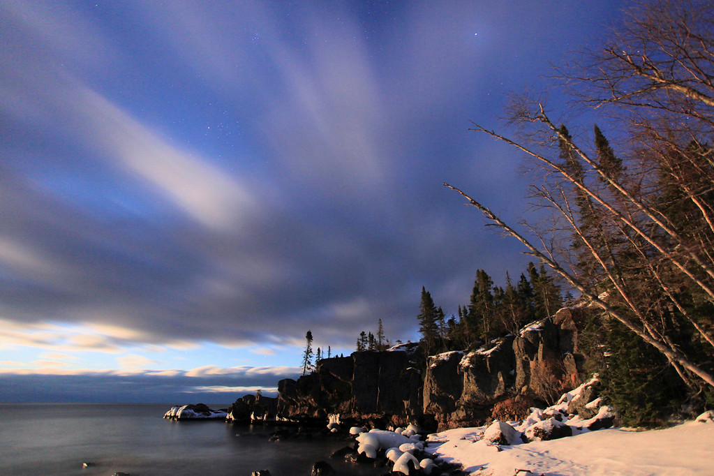 "JANUARY 9, 2012<br /> <br /> MOONLIGHT 4580-2<br /> <br /> ""Moonlit Shoreline - Lake Superior in Grand Portage, MN""<br /> <br /> Last night as the moon was rising the light on the surrounding landscape was sublime. The moonlight, clouds, stars and snowy landscape made for quite a memorable scene! I know I've said this many times before, but I can't help myself by saying it again: ""I LOVE living here!""<br /> <br /> Camera: Canon EOS 5D Mark II<br /> Lens: Canon EF 17-40mm<br /> Focal length: 17mm<br /> Shutter speed: 30 seconds<br /> Aperture: f/4<br /> ISO: 1000"