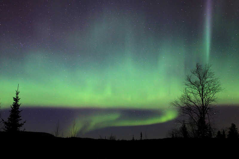 """THURSDAY, JANUARY 26, 2012<br /> <br /> AURORA 6283<br /> <br /> """"Wisps of Light""""<br /> <br /> Well, I've been suffering """"Aurora withdrawals"""" since our last two opportunities for Northern lights viewing in Northern Minnesota were cancelled due to heavy cloud cover. As a way of getting my """"fix"""", I went back to some photos from the night of March 10, 2011 and found a couple that I had not yet worked on. The photo you see here is one such photo. This was captured near the tail end of what I still consider to be the BEST Aurora display that I have ever seen. <br /> <br /> Camera: Canon EOS 5D Mark II<br /> Lens: Canon EF 17-40mm<br /> Focal length: 28mm<br /> Shutter speed: 20 seconds<br /> Aperture: f/4.5<br /> ISO: 1600"""