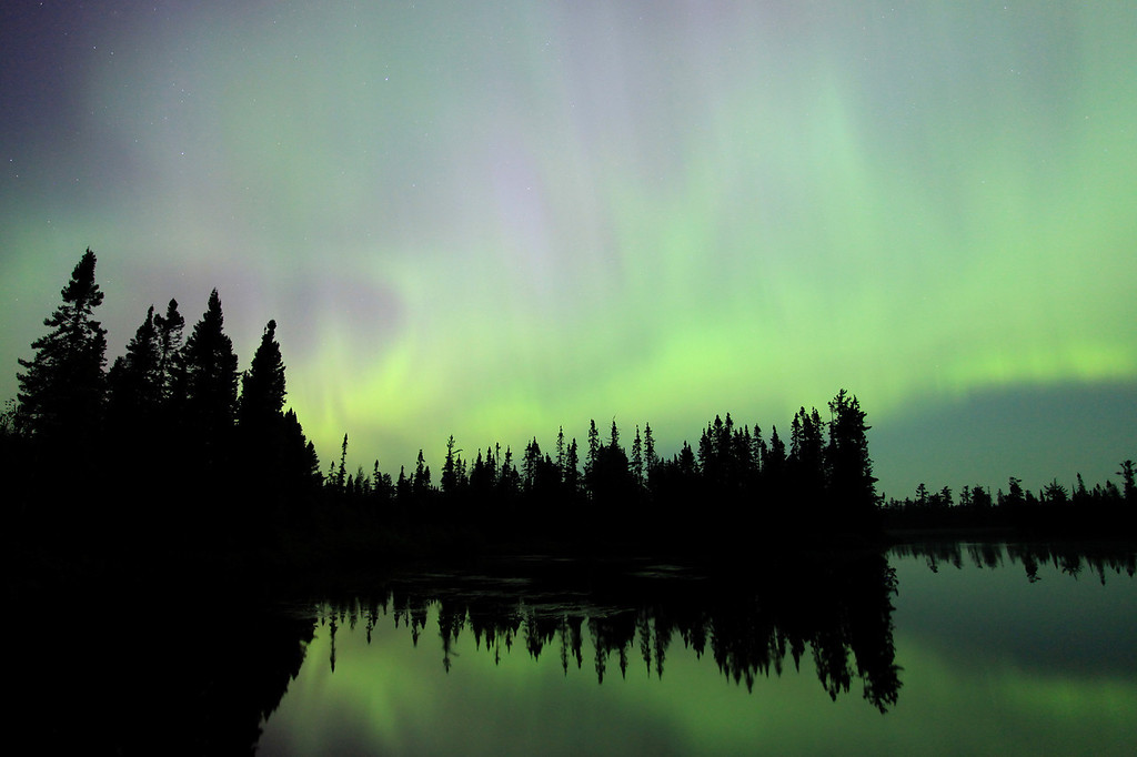 "MONDAY, JULY 16, 2012<br /> <br /> AURORA 1935<br /> <br /> ""Erupting Aurora over Devil Fish Lake""<br /> <br /> This was the first ""good"" shot that I made of the Aurora on July 15, 2012. This moment occurred at just after midnight after we had already been watching the sky for about two hours. My friends were starting to think that maybe we weren't going to see a sky full of active lights that night, they thought that maybe a faint glow was all we were going to get. I told them to be patient, it's not even midnight yet. Sure enough, just after midnight the sky erupted with lights. Once you've seen how quickly the aurora can erupt and fill the sky, it's a vision that never leaves your mind. It is a phenomena that makes you feel both insignificant in the universe and grand all at the same time. On the one hand you feel incredibly tiny, realizing that the source of these lights came all the way from the sun. On the other hand, when the lights are this active they seem so low in the sky that you can almost touch them... in a way almost touching the sun itself. Any way you look at it or ponder it, it certainly is one of nature's most breathtaking sights!<br /> <br /> Camera: Canon EOS 5D Mark II<br /> Lens: Canon EF 17-40mm<br /> Focal length: 17mm<br /> Shutter speed: 15 seconds<br /> Aperture: f/4<br /> ISO: 1600"