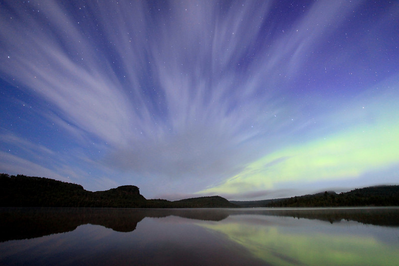 "TUESDAY, JULY 10, 2012<br /> <br /> AURORA 1239<br /> <br /> ""Night-time in the North Country""<br /> <br /> Here's another Aurora shot from last night. This one was taken just after 3:00 AM as the sky was starting to show the very first hints of daylight. Contrary to what this photo may lead you to believe, the clouds were NOT moving fast in this exposure. In fact, they were barely moving at all. Usually you only get this effect with the clouds when they are moving quickly through the scene. This was a 30 second exposure, but the clouds moved very little in that time.  They held this ""streaking"" formation for close to an hour. It was one of the coolest skies that I have ever seen.<br /> <br /> Camera: Canon EOS 5D Mark II<br /> Lens: Canon EF 17-40mm<br /> Focal length: 17mm<br /> Shutter speed: 30 seconds<br /> Aperture: f/4<br /> ISO: 2000"