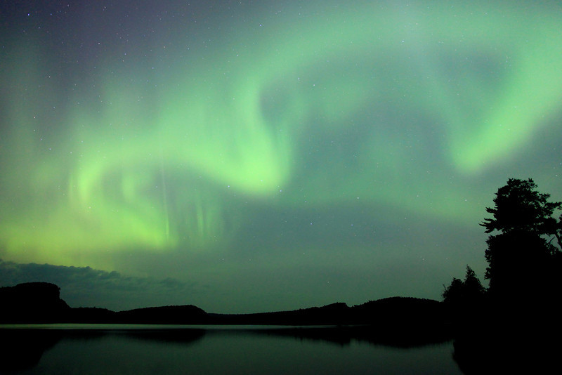 """MONDAY, JULY 16, 2012<br /> <br /> AURORA 2454<br /> <br /> """"Omega Aurora""""<br /> <br /> Northern lights dancing in the sky over McFarland Lake at the end of the Arrowhead Trail in Cook County, MN. <br /> <br /> Camera: Canon EOS 5D Mark II<br /> Lens: Canon EF 17-40mm<br /> Focal length: 17mm<br /> Shutter speed: 25 seconds<br /> Aperture: f/4<br /> ISO: 1600"""