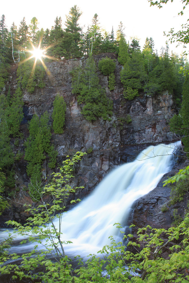 "TUESDAY, MAY 29, 2012<br /> <br /> RIVERS 7913<br /> <br /> ""Afternoon sun over Caribou Falls""<br /> <br /> Taken last Tuesday during our impromptu 'waterfall tour' down the shore. We stopped at a few different waterfalls that day, but Caribou Falls is always a highlight. Not very many people visit this one compared to many of the other north shore waterfalls, which means that you usually have some time to yourself to enjoy this beautiful drop in the river. We were lucky and got there just as the sun was dropping down behind the trees.<br /> <br /> Camera: Canon EOS 5D Mark II<br /> Lens: Canon EF 24-105mm<br /> Focal length: 28mm<br /> Shutter speed: 1.6 seconds<br /> Aperture: f/22<br /> ISO: 50"