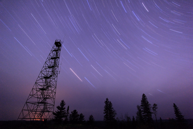 "SATURDAY, MAY 19, 2012<br /> <br /> STAR TRAILS 7460<br /> <br /> ""Fire Tower Star Trails""<br /> <br /> Here is a 43 minute exposure of the night sky taken last night, May 18, 2012.  There was supposedly a 40% chance of minor geomagnetic storms last night, so we went out to watch for the northern lights. We never saw any northern lights, but the stargazing was amazing.  There also was a line of thunderstorms moving across Canada about 20 miles north of where we were.  Since we were on top of a large hill with a good panoramic view, we were able to watch the lightning flash on the horizon while the sky directly above us was flooded with stars.  No northern lights, but still a beautiful night!<br /> <br /> (P.S. The lightning was all to the north, and this photo was taken looking to the west, which is why you cannot see any of the lightning in this photo). <br /> <br /> Camera: Canon EOS 5D Mark II<br /> Lens: Canon EF 17-40mm<br /> Focal length: 17mm<br /> Shutter speed: 43 minutes<br /> Aperture: f/4<br /> ISO: 400"
