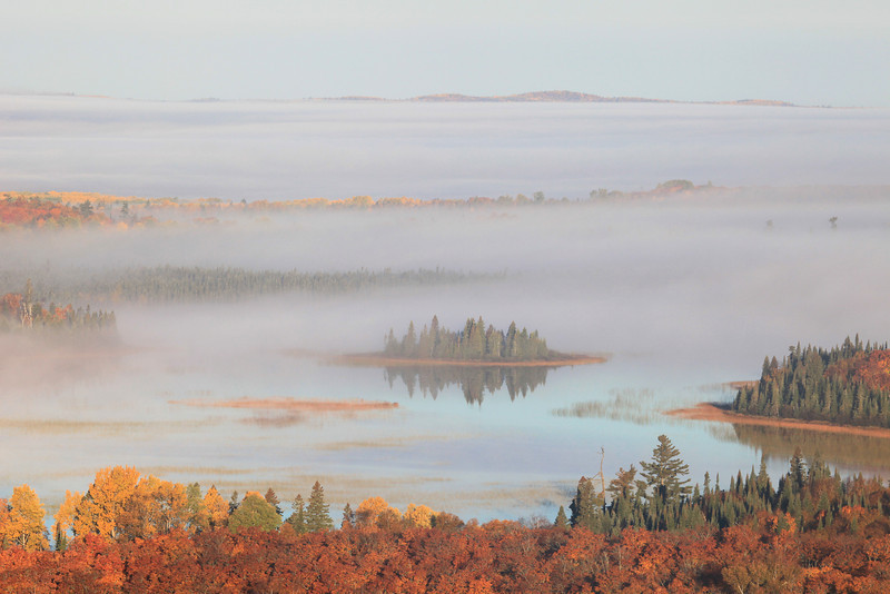 "TUESDAY, OCTOBER 2, 2012<br /> <br /> AUTUMN 7559<br /> <br /> ""Foggy autumn morning on Swamp Lake""<br /> <br /> This past Saturday we got up early to catch the morning light over Swamp Lake and photograph the (hopefully) awesome fall colors. On the drive up the mountain the colors were FANTASTIC but when we got to the top and looked down at the surrounding ridges we quickly noticed that the leaves in the valley below us were already past their peak color. That didn't really matter, though, because the fog stole the show. I've seen plenty of morning fog this time of year on the lake, but never this thick. It spread for miles and miles beyond the lake. We had about half an hour to view the lake and surrounding trees before the fog enveloped us. Once we were surrounded by fog we headed back down under the tree canopy to enjoy the fall colors up close and personal.<br /> <br /> Camera: Canon EOS 5D Mark II<br /> Lens: Canon EF 100-400mm<br /> Focal length: 220 mm<br /> Shutter speed: 1/250<br /> Aperture: f/16<br /> ISO: 400"