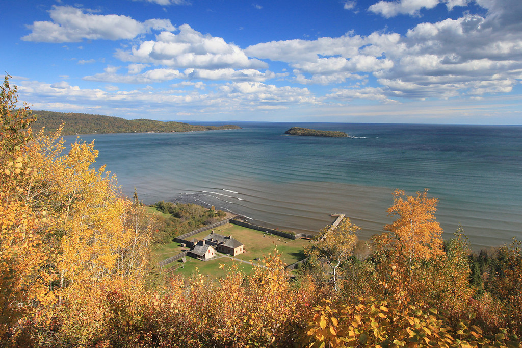 """MONDAY, OCTOBER 15, 2012<br /> <br /> GRAND PORTAGE 5716<br /> <br /> """"Autumn view of Grand Portage Bay from Mt. Rose""""<br /> <br /> Our fall color season seemed to pass in the blink of an eye this year. I didn't do nearly the amount of fall color shooting that I've done in past years, but I did manage to get out and find some beautiful scenes to photograph. One of my favorite examples is this scene from the summit of the Mt. Rose hiking trail in Grand Portage National Monument. It was a windy day when I made this shot, and the lines of waves coming in off Lake Superior gave additional character to the water that I found intriguing. If you've never done the Mt. Rose trail, you should do it sometime. It's a beautiful hike with a very rewarding (as you can see here) view from the summit.<br /> <br /> Camera: Canon EOS 5D Mark II<br /> Lens: Canon EF 17-40mm<br /> Focal length: 23mm<br /> Shutter speed: 1/100<br /> Aperture: f/16<br /> ISO: 500"""