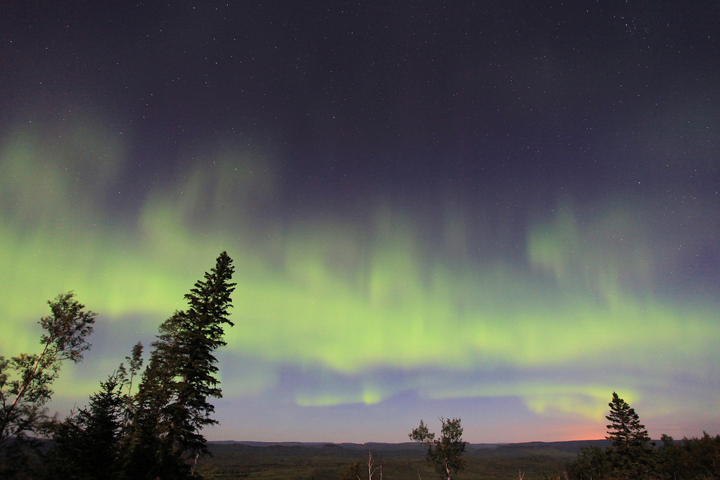 """SUNDAY, OCTOBER 14, 2012<br /> <br /> AURORA 2213<br /> <br /> """"Mt. Maude Aurora""""<br /> <br /> Grand Portage is sitting beneath a thick blanket of clouds right now, but I am optimistic that the clouds will part later this evening and we will get a glimpse of the Auroras that they say MAY be happening tonight. I definitely need an Aurora fix... the last really good ones I was able to photograph were in mid-July. I've seen a few since then, but they weren't anything to write home about. They also occurred during a full moon so they were difficult to see and even more difficult to photograph. Keeping my fingers crossed for a good opportunity tonight! In the meantime, today I was going through some more Aurora shots from last year and found several that I hadn't worked up yet. Here's one from the night of September 10, 2011.<br /> <br /> Camera: Canon EOS 5D Mark II<br /> Lens: Canon EF 17-40mm<br /> Focal length: 17mm<br /> Shutter speed: 13 seconds<br /> Aperture: f/4<br /> ISO: 800"""