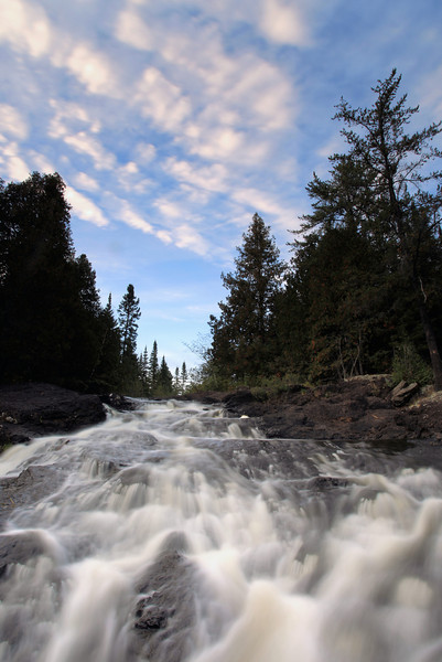 """FRIDAY, SEPTEMBER 14, 2012<br /> <br /> RIVERS 5344<br /> <br /> """"Thompson Falls, Cascade River""""<br /> <br /> A couple of days ago we visited Thompson Falls on the Cascade River, a waterfall I had never heard of until recently. It turned out to be a gem of a waterfall, with seemingly limitless photo possibilities. The main channel of the river is fantastic as it tumbles over the falls, but I actually had more fun photographing these little side falls on the west bank of the river. The photo below shows two drops out of what is actually a 3-drop series of falls. The upper two falls were what really caught my eye, though, especially with these beautiful cedar branches framing the right side of the photo. I can't wait to go back and spend more time at these falls!<br /> <br /> Camera: Canon EOS 5D Mark II<br /> Lens: Canon EF 17-40mm<br /> Focal length: 17mm<br /> Shutter speed: 2.5 seconds<br /> Aperture: f/22<br /> ISO: 50"""