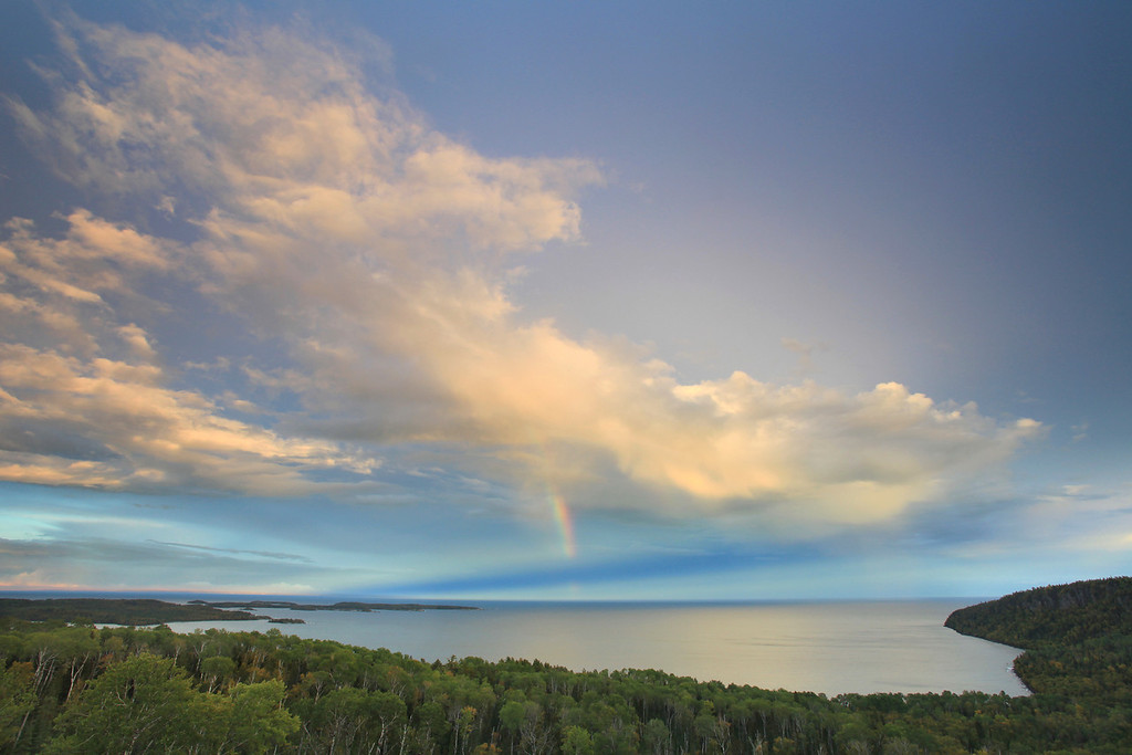 "THURSDAY, SEPTEMBER 20, 2012<br /> <br /> SUPERIOR FALL 5418<br /> <br /> ""Clearing autumn storm over Wauswaugoning Bay and the Susie Islands""<br /> <br /> Last night as I drove home from work the clouds over Lake Superior were irresistable. I just had to take some time and photograph the clouds as the rain squalls were breaking up over the lake. There was a hint of a rainbow in the middle of this cloud as it drifted out over the bay. Both the clouds and the light were changing very quickly, making it very enjoyable to sit and just enjoy the view after making some photographs of the scene.<br /> <br /> Camera: Canon EOS 5D Mark II<br /> Lens: Canon EF 17-40mm<br /> Focal length: 17mm<br /> Shutter speed: 1/4<br /> Aperture: f/16<br /> ISO: 200"