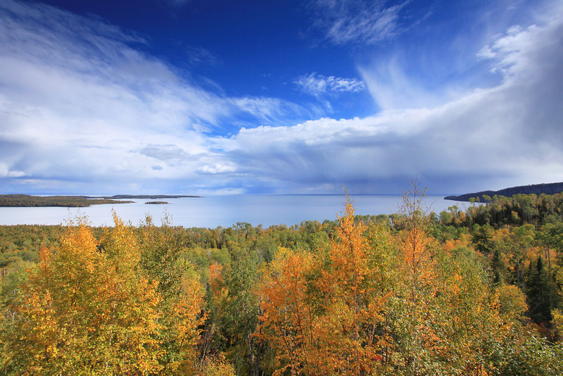 "FRIDAY, SEPTEMBER 21, 2012<br /> <br /> SUPERIOR FALL 5692<br /> <br /> ""Early autumn colors on Wauswaugoning Bay""<br /> <br /> This afternoon's view from the Highway 61 pullout on Mt. Josephine in Grand Portage. With the rain showers we've been getting over the past couple of days, the leaves seem to be taking on a bit more vibrancy than they had before the rain. The colors are popping out everywhere now and the next couple of weeks should be good for leaf watchers!<br /> <br /> Camera: Canon EOS 5D Mark II<br /> Lens: Canon EF 17-40mm<br /> Focal length: 17mm<br /> Shutter speed: 1/200<br /> Aperture: f/16<br /> ISO: 400"