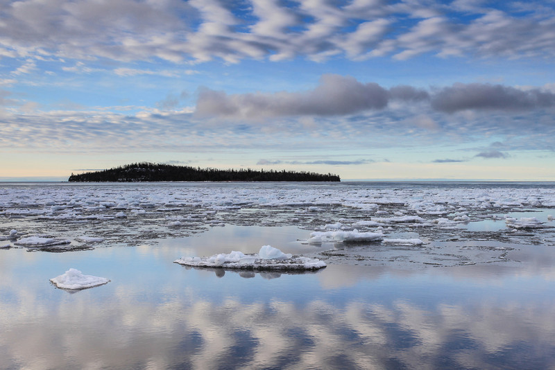 """TUESDAY, APRIL 16, 2013<br /> <br /> SUPERIOR SPRING 2130<br /> <br /> """"Spring Reflections on Grand Portage Bay""""<br /> <br /> Camera: Canon EOS 5D Mark II<br /> Lens: Canon EF 17-40mm<br /> Focal length: 40mm<br /> Shutter speed: 1/30<br /> Aperture: f/16<br /> ISO: 200"""