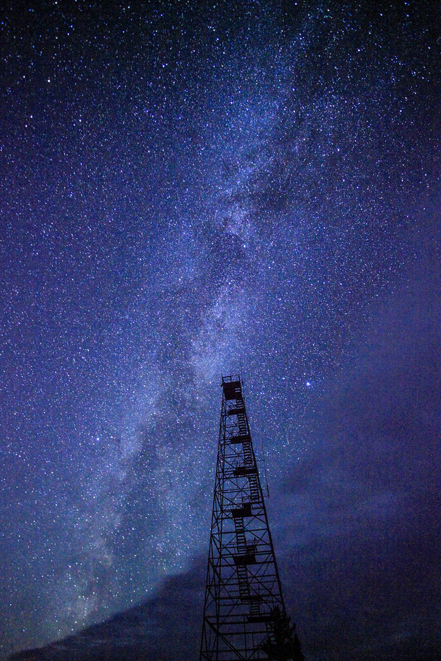 """TUESDAY, AUGUST 13, 2013<br /> <br /> MILKY WAY 9044<br /> <br /> """"Cloud Galaxy""""<br /> <br /> Last night we headed out to try and do some photography of the annual Perseid meteor shower.  For about the past week we have been seeing quite a few meteors streaking through the sky each night, but last night was supposed to be the """"peak"""" of the shower.  We stayed out from about 10:30 PM until 3:00 AM and while we did see a lot of meteors, it didn't seem to be quite as many as last year.  The view of the Milky Way Galaxy is what really stole the show.  We started off our evening at Paradise Beach just south of Judge Magney State Park and the view of the Milky Way over Lake Superior was tremendous.  As we sat and enjoyed the view we heard wolves howling off in the distance.  A couple of hours later we packed up and headed to one of the fire towers in Grand Portage.  When we got there, however, a very large cloud bank was moving in from the west and we were only able to get a few shots in before the Milky Way was completely obscured by the clouds.  In this photo you can see the edge of the cloud along the bottom of the photo.  I thought it made for a pretty interesting image to show that cloud advancing over the Milky Way with the fire tower in the foreground.  It was a fun night outside, and to go along with hearing the wolves we also saw a pine marten and a small rabbit, both of which ran down the road in front of us at different times.  So, not only a good night for stargazing but also a good night for wildlife!<br /> <br /> Camera: Canon EOS 5D Mark II<br /> Lens: Canon EF 17-40mm<br /> Focal length: 17mm<br /> Shutter speed: 30 seconds<br /> Aperture: f/4<br /> ISO: 12800"""