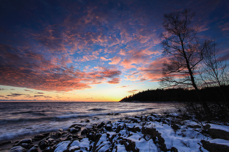 "FRIDAY, JANUARY 4, 2013<br /> <br /> SUPERIOR WINTER 8755<br /> <br /> ""January Sunset over Whitecaps Bay""<br /> <br /> Last night's sunset was pretty amazing.  Easily the best one that I've photographed so far this winter.  I get done with work at 4:00 on Thursdays so I really had to move to get to my planned spot in time, but I did make it and it was worth the dash.  I stayed at this location until about 45 minutes after the sun went down and had a lot of fun photographing the changing light, colors and waves.  An added bonus was seeing some fox tracks in the snow going along the rocks in the foreground.  If you look closely you can see some of the tracks in the lower right corner of the frame. <br /> <br /> Camera: Canon EOS 5D Mark II<br /> Lens: Canon EF 17-40mm<br /> Focal length: 17mm<br /> Shutter speed: 0.8 sec<br /> Aperture: f/16<br /> ISO: 50"