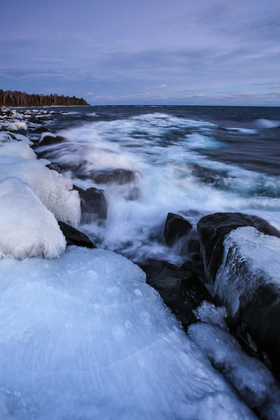 "SATURDAY, JANUARY 5, 2013<br /> <br /> SUPERIOR WINTER 8777<br /> <br /> ""Ice-Covered Shores""<br /> <br /> Here is a recent shot taken at dusk looking east along the Lake Superior shoreline in Grand Portage. It was a wind-stricken shore with big waves on this particular evening of January 3rd, 2013. The lines in the foreground ice are what really caught my eye here, but I think the frothy waves in the background add a lot to the image as well. Enjoy!<br /> <br /> Camera: Canon EOS 5D Mark II<br /> Lens: Canon EF 17-40mm<br /> Focal length: 17mm<br /> Shutter speed: 0.4 sec<br /> Aperture: f/10<br /> ISO: 800"
