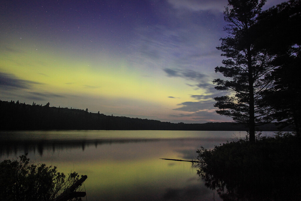 """SATURDAY, JULY 6, 2013<br /> <br /> AURORA 4768<br /> <br /> """"Sky Glow over Speckled Trout Lake""""<br /> <br /> After the moose sighting  last night I continued up the road to Speckled Trout Lake where I was hoping to see some aurora activity.  When I arrived at the lake the sky was mostly clear and indeed there were some northern lights visible in the sky!  They weren't spectacular dancing and shimmering lights like the other ones I've seen recently, but still it's always nice to see the aurora.  Basically there was this large band of soft light sort of hovering in the sky.  It actually looked like a cloud, except that it wasn't moving.  The color just sort of hung there for a long time.  This photo was made at about 3:30 in the morning, which means that there was a little bit of daylight starting to creep into the sky.  Unfortunately the bugs were TERRIBLE, but still it was fun to be out in the woods seeing the moose and the aurora and the fireflies, which were EVERYWHERE!   <br /> <br /> Camera: Canon EOS 5D Mark II<br /> Lens: Canon EF 17-40mm<br /> Focal length: 17mm<br /> Shutter speed: 30 seconds<br /> Aperture: f/4<br /> ISO: 1600"""