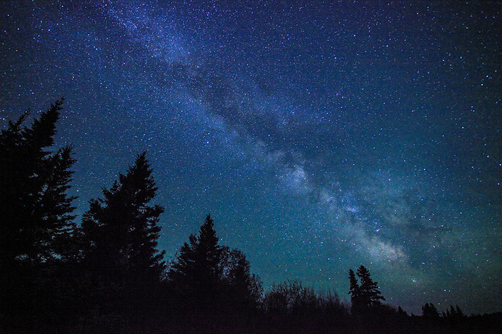 "SUNDAY, JUNE 9, 2013<br /> <br /> MILKY WAY 4275<br /> <br /> ""Galaxy Forest""<br /> <br /> Last night Jessica and I got out to enjoy the supremely calm conditions that were prevalent across northeast Minnesota.  The conditions were so calm that I have never seen stars reflecting so perfectly in the waters of Lake Superior as they were last night.  We were treated to incredible views of the Milky Way Galaxy, which was our focus for the evening but we were also (as always) hoping to see some northern lights that were possible overnight.  The aurora never happened but the extreme calm of the night air combined with stars that were literally jumping out of the sky at us made for an unforgettable experience.  Tonight is a stark contrast to last night as we are experiencing some rainfall and wind.  Every day is different!  I love it :-)<br /> <br /> Camera: Canon EOS 5D Mark II<br /> Lens: Canon EF 17-40mm<br /> Focal length: 17mm<br /> Shutter speed: 30 seconds<br /> Aperture: f/4<br /> ISO: 6400"