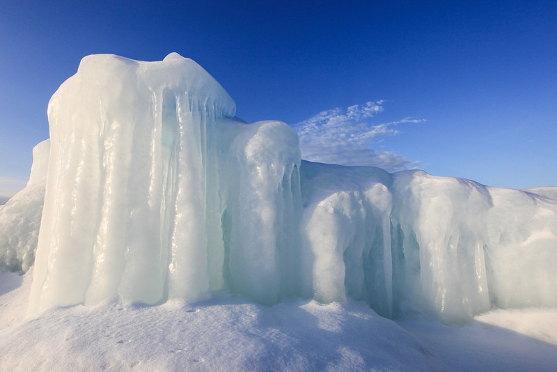 "WEDNESDAY, MARCH 13, 2013<br /> <br /> SUPERIOR WINTER 1248<br /> <br /> ""Fortress of Ice""<br /> <br /> This ice formation was photographed along the Grand Portage shoreline of Lake Superior a few days ago.  It never ceases to amaze me the endless forms that ice can take along the shores of this great lake. This ""fortress"" of ice formed over the top of a large mound of rocks.  As the rocks get pounded by the waves the water freezes and forms into ice.  Every year the ice looks different, as it never freezes in the same exact shape.  Often times even from one day to the next it will look different as new waves add new layers of ice, or warm days melt a layer of ice. <br /> <br /> Camera: Canon EOS 5D Mark II<br /> Lens: Canon EF 17-40mm<br /> Focal length: 17mm<br /> Shutter speed: 1/200 sec<br /> Aperture: f/16<br /> ISO: 400"