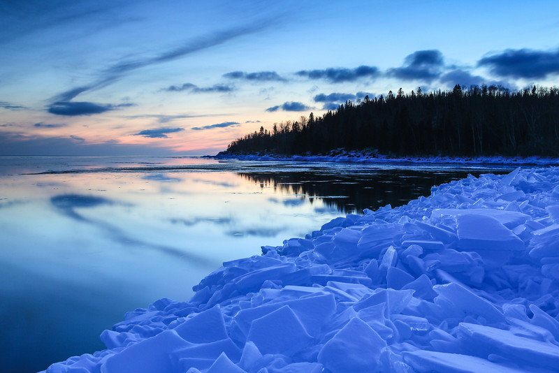 "FRIDAY, MARCH 1, 2013<br /> <br /> SUPERIOR WINTER 1124<br /> <br /> ""Serenity on the ice""<br /> <br /> Here's an image from the last sunset I shot a few days ago.  It was one of the quietest evenings I've ever experienced on Lake Superior.  There was absolutely no wind and not a single ripple on the water to disturb the evening.  The sunset didn't yield much of a display in terms of color, but the clouds and their matching reflections on the surface of the lake were a sight to behold.  <br /> <br /> Camera: Canon EOS 5D Mark II<br /> Lens: Canon EF 17-40mm<br /> Focal length: 37mm<br /> Shutter speed: 10 seconds<br /> Aperture: f/16<br /> ISO: 200"