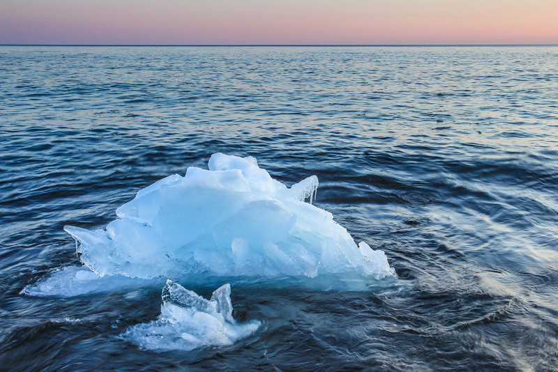 "THURSDAY, MARCH 14, 2013<br /> <br /> SUPERIOR WINTER 1338<br /> <br /> ""March Iceberg""<br /> <br /> I took this picture at sunset last night, a very mild evening with a temp right around 30 degrees.  I found a lot of ice chunks that had broken off from the shoreline and were floating around like icebergs.  This one had the most intriguing shape out of the bunch.  <br /> <br /> Camera: Canon EOS 5D Mark II<br /> Lens: Canon EF 17-40mm<br /> Focal length: 32mm<br /> Shutter speed: 1/10<br /> Aperture: f/16<br /> ISO: 400"