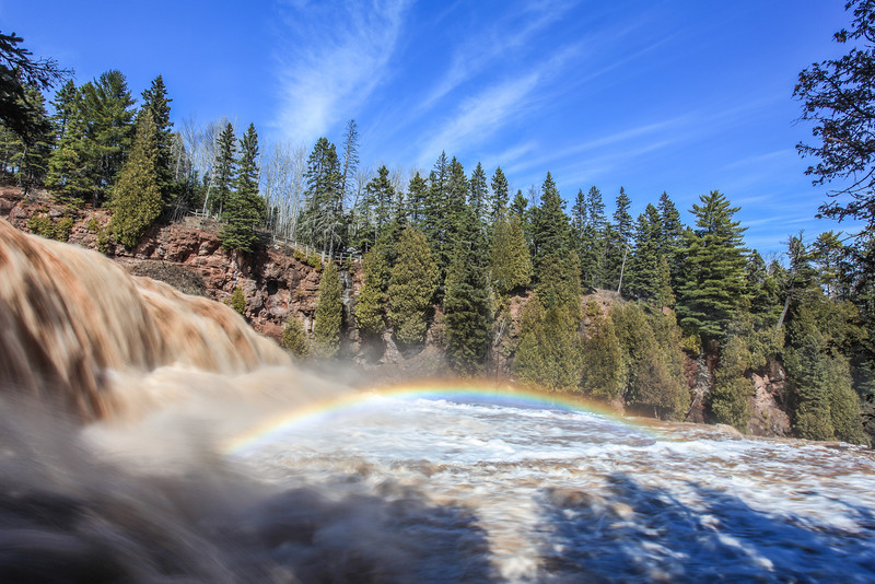 "WEDNESDAY, MAY 1, 2013<br /> <br /> GOOSEBERRY RIVER 2665<br /> <br /> ""Spring Rainbow at Gooseberry Falls""<br /> <br /> After photographing the high water on the Beaver River I continued down the shore to Gooseberry Falls State Park.  Gooseberry is a park that is absolutely loaded with photographic potential.  In a relatively short stretch of river there are numerous waterfalls with endless photo possibilities.  I spent about an hour and a half at the park and not only was the river nice and high but the clouds were very cool which really added interest to the photos I took.  I also saw several rainbows but my favorite was the one at the base of the main waterfall.  <br /> <br /> Camera: Canon EOS 5D Mark II<br /> Lens: Canon EF 17-40mm<br /> Focal length: 20mm<br /> Shutter speed: 1/8 sec<br /> Aperture: f/22<br /> ISO: 50"