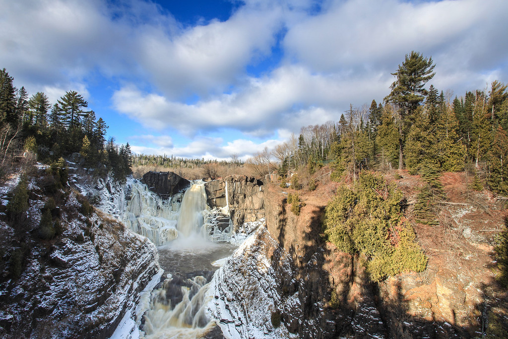 "TUESDAY, NOVEMBER 26, 2013<br /> <br /> PIGEON RIVER 7515<br /> <br /> ""Early winter on the High Falls Gorge of the Pigeon River""<br /> <br /> Winter is coming, which is becoming evident at High Falls on the Pigeon River in Grand Portage State Park.  This photo was taken yesterday afternoon when the sky was filled with beautiful clouds.  I was a little surprised by the amount of ice already forming on the face of the falls, but then I realized that it is almost December already!  I just love this photo of the falls.  I think it is one of my new favorites of this location.  I love the clouds, the ice, the tree shadows and the light.  When I first arrived at the falls the sky was almost completely clear of clouds and by the time I left the cloud cover was really heavy, with no blue sky at all visible.  Everything came together for this shot, and I happened to be there at just the right time to capture it!<br /> <br /> Camera: Canon EOS 5D Mark II<br /> Lens: Canon EF 17-40mm<br /> Focal length: 35mm<br /> Shutter speed: 1/4<br /> Aperture: f/22<br /> ISO: 50"