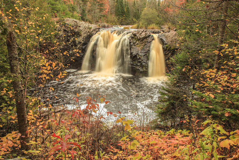 """FRIDAY, NOVEMBER 1, 2013<br /> <br /> WISCONSIN 3062<br /> <br /> """"Autumn's Last Call - Little Manitou Falls""""<br /> <br /> After our recent trip to Wisconsin to photograph Sandhill Cranes we decided to take a different route home from the route we usually take. We traveled home through Wisconsin via Highway 35, which brought us right through Pattison State Park.  Pattison has two very nice waterfalls that are very easy to see after a short walk on the park trails.  A drop of 165 feet makes Big Manitou Falls the tallest waterfall in Wisconsin.  While fascinating to see, I did not find Big Manitou Falls overly interesting to photograph.  I had more fun photographing Little Manitou Falls, which is 31 feet high according to the park literature.  I just found the shape and overall character of the smaller waterfall to be more interesting than the big one. We enjoyed this park and will be stopping here again in the future for sure!<br /> <br /> Camera: Canon EOS 5D Mark II<br /> Lens: Canon EF 24-105mm<br /> Focal length: 28mm<br /> Shutter speed: 0.3 sec<br /> Aperture: f/22<br /> ISO: 50"""