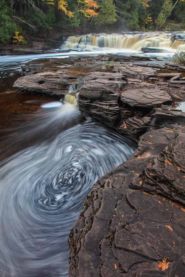 "WEDNESDAY, OCTOBER 16, 2013<br /> <br /> MICHIGAN 2605<br /> <br /> ""Foam Pool at Manido Falls""<br /> <br /> Here is another shot from Manido Falls on the Presque Isle River that I've been anxious to share.  This is a 6 second exposure that shows the movement of foam below the falls.  I loved this little pool on the side of the river because the foam was moving in slow circles which made for an intriguing long-exposure image.  I sure wish I lived closer to this river, as it is an amazing one to photograph!  <br /> <br /> Camera: Canon EOS 5D Mark II<br /> Lens: Canon EF 24-105mm<br /> Focal length: 24mm<br /> Shutter speed: 6 seconds<br /> Aperture: f/22<br /> ISO: 50"