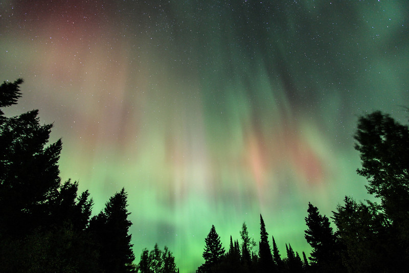 """WEDNESDAY, OCTOBER 2, 2013<br /> <br /> AURORA 1734<br /> <br /> """"October Explosion""""<br /> <br /> WOW!  There were some awesome surprise northern lights last night!  Spaceweather.com said:  """"Arriving a little earlier than expected, a CME (Coronal Mass Ejection) hit Earth's magnetic field on October 2nd at approximately 0200 UT.  The impact sparked a G2-class geomagnetic storm with auroras across Canada and several northern-tier states.""""<br /> <br /> Jessica and I had just finished watching a movie and were about to start getting ready for bed.  Jessica was looking at Facebook when she noticed there were some posts about the northern lights being out.  So, we looked at the Aurora Soft Serve News site and sure enough, they were indicating the aurora was at STORM level!  I had been super-tired just moments before, but I was quickly wide awake again after walking out onto our deck and seeing a large, glowing arc of aurora over Mt. Josephine in our backyard.  Of course what happened next should be obvious.  I gathered my gear and hopped in the truck, heading inland to photograph the lights.  I spent the next 4 hours watching probably the best aurora storm to occur yet this year.  The photo you see here was the very first exposure I made of the lights.  After this I made about another 180 images of the dancing lights before heading back home for the night.<br /> <br /> Camera: Canon EOS 5D Mark II<br /> Lens: Canon EF 17-40mm<br /> Focal length: 17mm<br /> Shutter speed: 30 seconds<br /> Aperture: f/4<br /> ISO: 1000"""