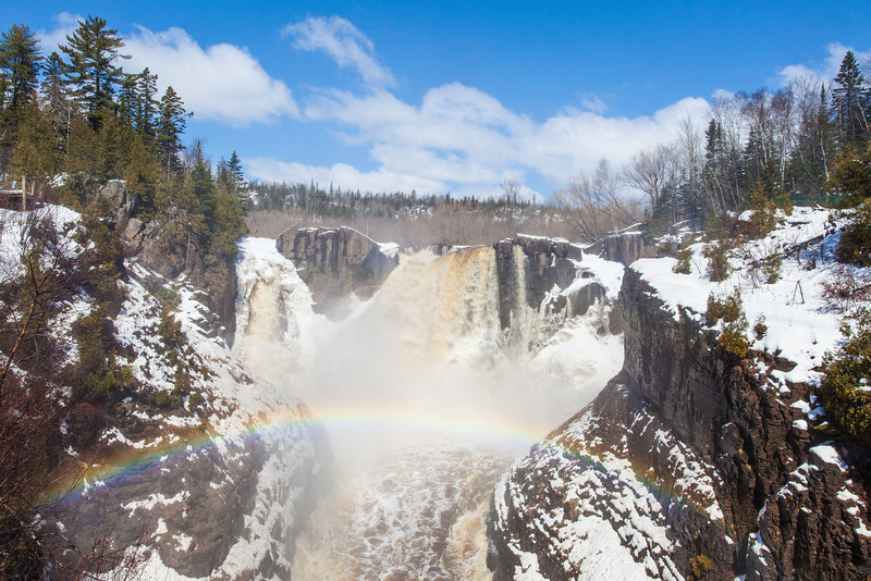 """SUNDAY, APRIL 27, 2014<br /> <br /> PIGEON RIVER 4395<br /> <br /> """"Snowy Spring Rainbow at High Falls""""<br /> <br /> The conditions for waterfall watching are at their prime!  Here was the scene yesterday at High Falls of the Pigeon River in Grand Portage State Park.  It was a sunny, blue sky day combined with nice clouds, snow and an awesome rainbow!  <br /> <br /> Camera: Canon EOS 5D Mark II<br /> Lens: Canon EF 17-40mm<br /> Focal length: 25mm<br /> Shutter speed: 1/400<br /> Aperture: f/16<br /> ISO: 400"""