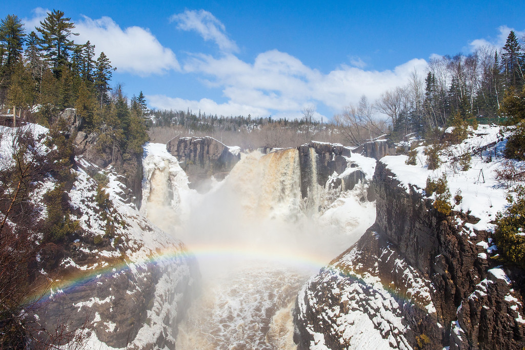 "SUNDAY, APRIL 27, 2014<br /> <br /> PIGEON RIVER 4395<br /> <br /> ""Snowy Spring Rainbow at High Falls""<br /> <br /> The conditions for waterfall watching are at their prime!  Here was the scene yesterday at High Falls of the Pigeon River in Grand Portage State Park.  It was a sunny, blue sky day combined with nice clouds, snow and an awesome rainbow!  <br /> <br /> Camera: Canon EOS 5D Mark II<br /> Lens: Canon EF 17-40mm<br /> Focal length: 25mm<br /> Shutter speed: 1/400<br /> Aperture: f/16<br /> ISO: 400"