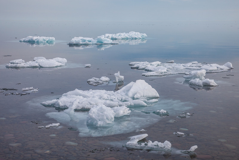 "SATURDAY, APRIL 12, 2014<br /> <br /> SUPERIOR SPRING 2891<br /> <br /> ""Big Lake Bergs""<br /> <br /> We were driving to Grand Marais the other evening to have dinner with some friends when we spotted these icebergs floating close to shore.  I looked at Jessica and said ""We have to stop!""  We spent just about 5 minutes photographing these icebergs.  They were fascinating!  I loved how you could see the ice both above and below the waterline.  Sadly, with the wind (and the warm temperatures) these icebergs are no longer there.  They've either melted or been blown across the lake.  <br /> <br /> Camera: Canon EOS 5D Mark II<br /> Lens: Canon EF 24-105mm<br /> Focal length: 60mm<br /> Shutter speed: 1/400<br /> Aperture: f/11<br /> ISO: 200"