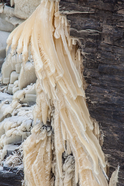 "FRIDAY, APRIL 18, 2014<br /> <br /> ABSTRACT 3346<br /> <br /> ""Hanging Ice at High Falls""<br /> <br /> There are some really cool ice formations hanging from the rock walls of the Pigeon River gorge just below High Falls right now.  These likely won't last long as we're in for some pretty warm temperatures in the days ahead.  For now, though, it is a fascinating sight!  The ice was made by freezing mist coming off the falls and hitting the rocks.  <br /> <br /> Camera: Canon EOS 5D Mark II<br /> Lens: Tamron SP 150-600mm<br /> Focal length: 600mm<br /> Shutter speed: 1/50<br /> Aperture: f/16<br /> ISO: 200"